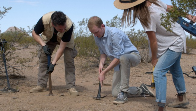 TUCSON, ARIZ.- (Left to Right) Geoff and Charlie uncover a meteorite, as Kirby watches. (Photo credit: National Geographic Channels/Jill Littman)