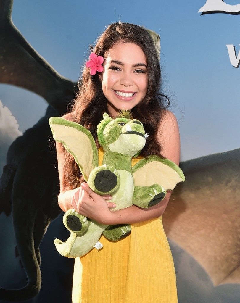 """HOLLYWOOD, CA - AUGUST 08: Actress Auli'i Cravalho arrives at the world premiere of Disney's """"PETE'S DRAGON"""" at the El Capitan Theater in Hollywood on August 8, 2016. The new film, which stars Bryce Dallas Howard, Robert Redford, Oakes Fegley, Oona Laurence, Wes Bentley and Karl Urban and is written and directed by David Lowery, has been drawing rave reviews from both audiences and critics. PETE'S DRAGON opens nationwide August 12, 2016. (Photo by Alberto E. Rodriguez/Getty Images for Disney ) *** Local Caption *** Auli'i Cravalho"""